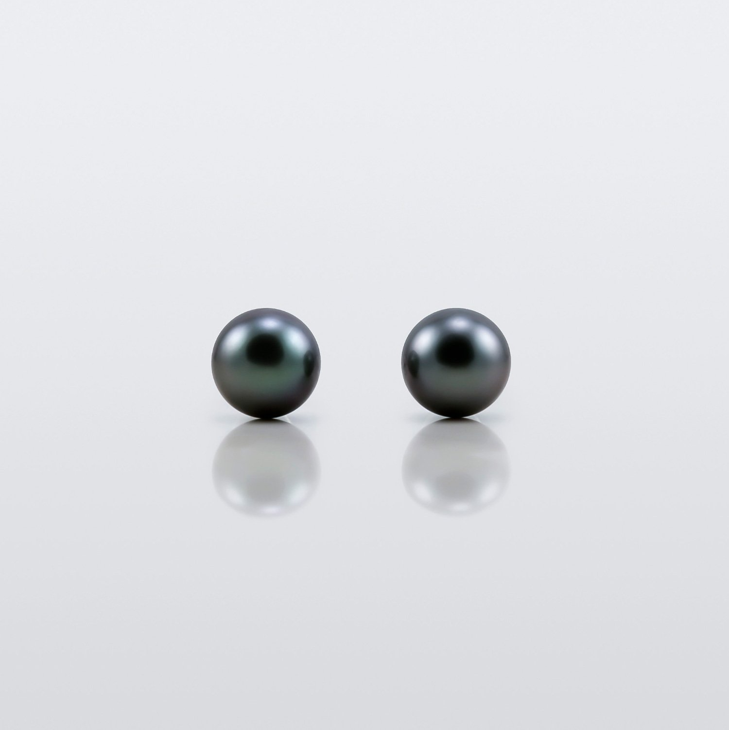 Selene, Black Tahitian Pearl Stud Earrings on a model